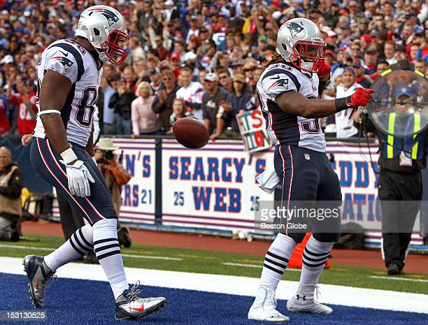 A jubilant New England Patriots running back Brandon Bolden celebrates his sevenyard touchdown run in the fourth quarter as the Patriots took on the...