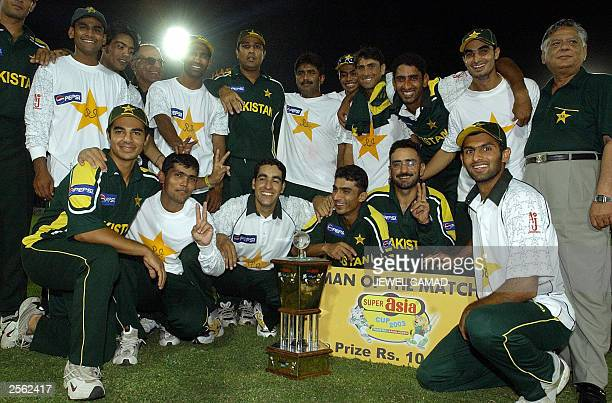 A jubilant Pakistani cricket team pose for photographers after their victory over Bangladesh in the fifth One Day International match in Karachi 21...
