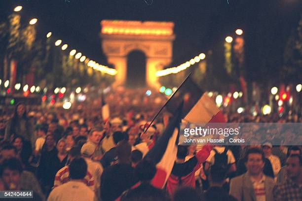 Jubilant Parisians on the Champs Elysees after France's victory over Croatia in the semi finals