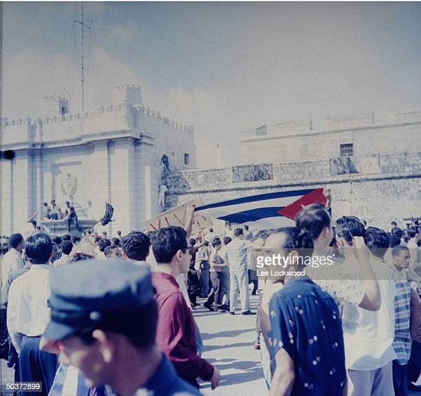 Jubilant population gathering on Havana streets as victorious Castro and rebel army head toward city