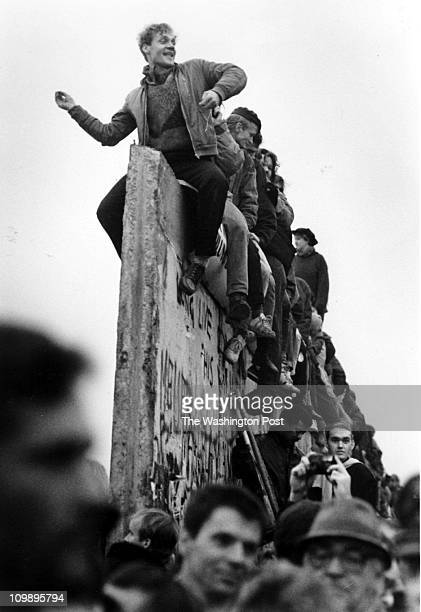 01/01/90 Jubilant West Berliners celebrate a new opening in the Berlin Wall Photo By Carol Guzy TWP