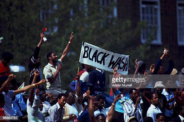 Jubilant West Indies supporters holding up a 'Black Wash' banner during the 5th Test Match between England and the West Indies at the Oval, London,...
