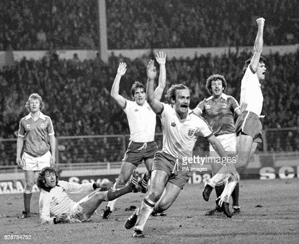 Jubilation from England players Bob Latchford Mick Mills and Dave Watson after Watson had headed home England's third goal after 50 minutes' play in...