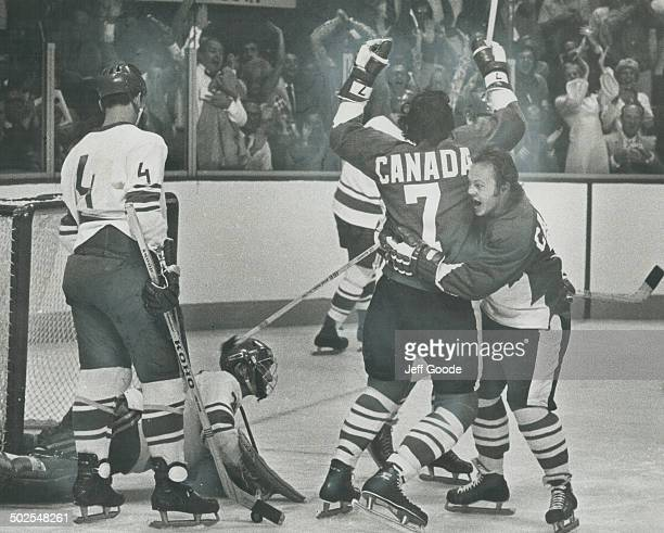 Jubilation Yvan Cournoyer embraces teammate Phil Esposito who is jumping for joy after scoring first goal for Team Canada against Soviet Nationals...