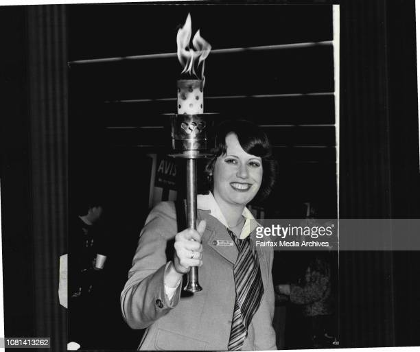 Jubilee Flame arrives from England by Qantas accompanied by Miss Linda Coles a Qantas ticket sales agent from Piccadilly in London June 9 1977