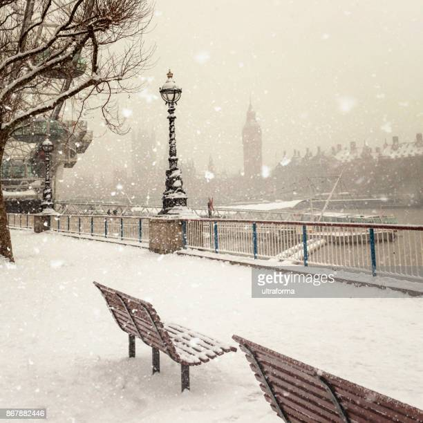 jubilee gardens and westminster palace during a snowstorm in london at day - christmas scenes stock photos and pictures