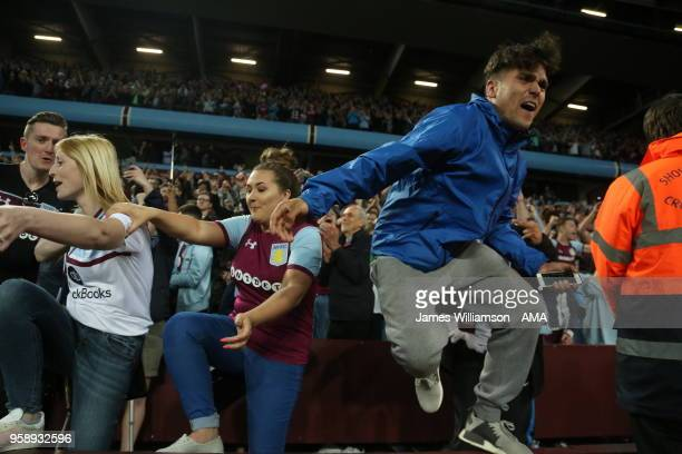 Jubilent Aston Villa fans at full time of the Sky Bet Championship Play Off Semi FinalSecond Leg match between Aston Villa and Middlesbrough at Villa...