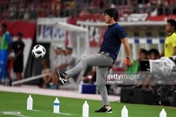 Jubilo Iwata head coach Hiroshi Nanami kicks the ball during the JLeague J1 match between Kashima Antlers and Jubilo Iwata at Kashima Soccer Stadium...