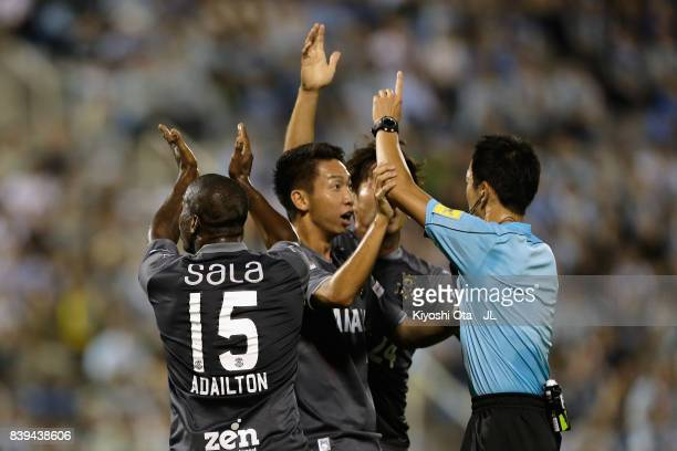 Jubilo Iwata players protest to referee Jumpei Iida after Adailton's shot was cleared off the goal line during the JLeague J1 match between Jubilo...