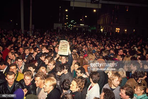 Jublilant crowds celebrate freedom at Checkpoint Charlie at the Berlin Wall on the night of November 9th 1989 when it opened