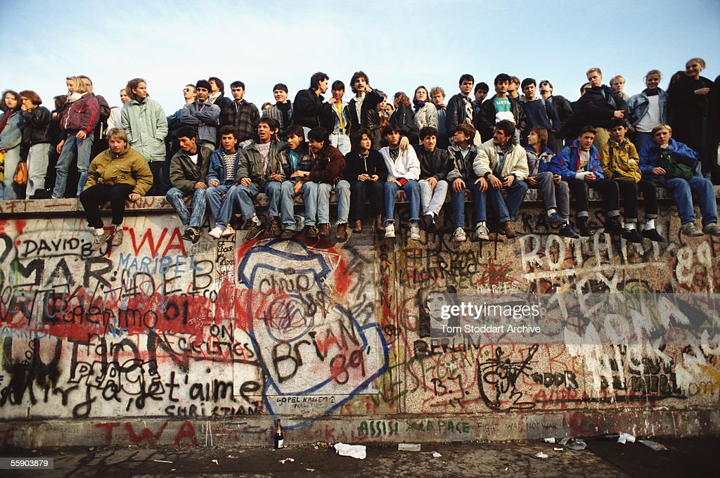Jublilant crowds celebrate freedom on top of the Berlin Wall on the morning of November 10th 1989.
