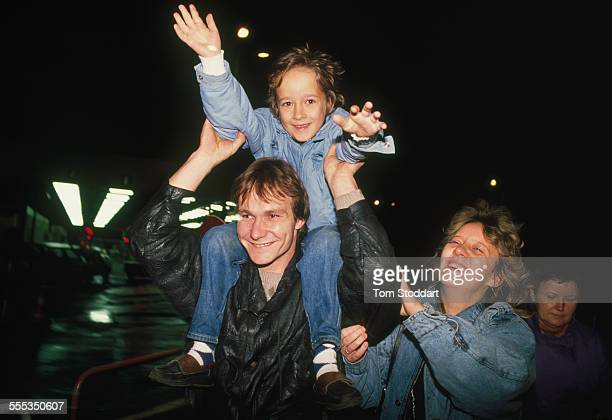 A jublilant family celebrate freedom after crossing from East Berlin at Checkpoint Charlie on the night of November 9 1989 when it opened