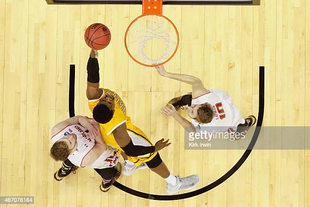 Jubril Adekoya of the Valparaiso Crusaders looks for a shot between Evan Smotrycz and Jared Nickens of the Maryland Terrapins during the second round...