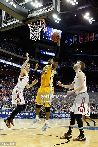 Jubril Adekoya of the Valparaiso Crusaders takes a shot against Jake Layman of the Maryland Terrapins during the second round of the Men's NCAA...