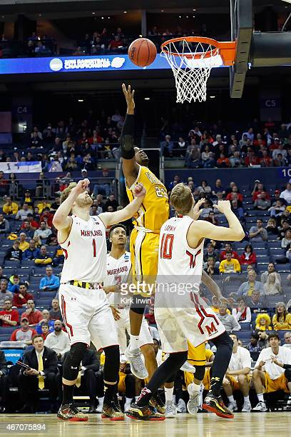 Jubril Adekoya of the Valparaiso Crusaders takes a shot over Jake Layman of the Maryland Terrapins during the second round of the Men's NCAA...