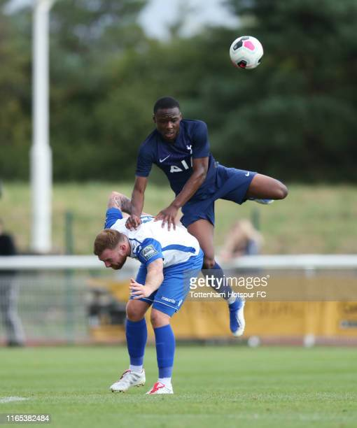 Jubril Okedina of Tottenham Hotspur and Billy Bricknell of Enfield Town during the preseason friendly match between Enfield Town and Tottenham...