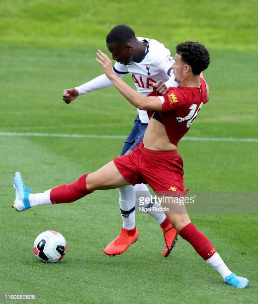 Jubril Okedina of Tottenham Hotspur challenges Curtis Jones of Liverpool during the Premier League 2 match between Liverpool U23 and Tottenham...