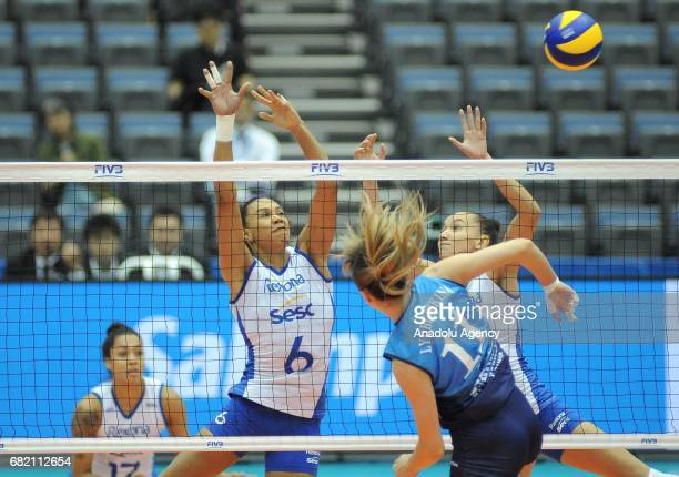 Juceila Barreto and Ana Da Silva of RexonaSesc in action against Ekaterina Lyubuchkina during the pool match of the FIVB Womens Club World...