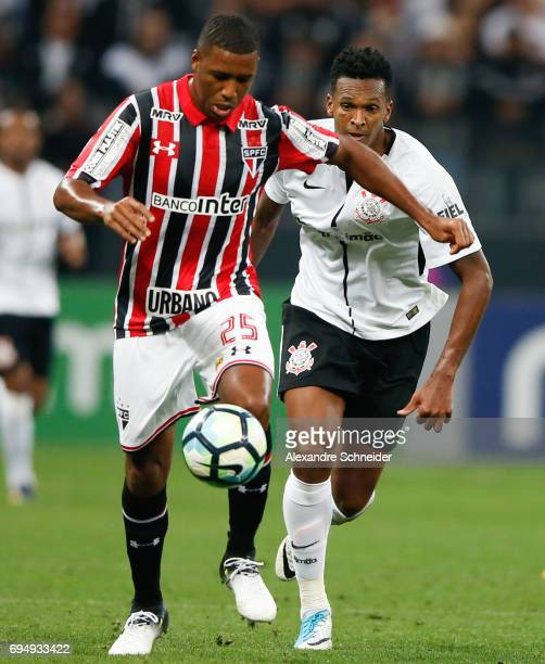 Jucilei of Sao Paulo and Jo of Corinthians of Corinthians in action during the match between Corinthians and Sao Paulo for the Brasileirao Series A...