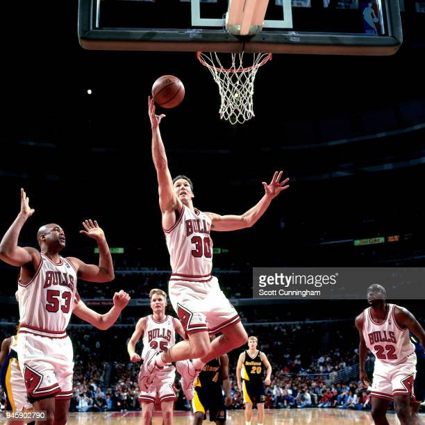Jud Buechler of the Chicago Bulls grabs the rebound against the Indiana Pacers on April 20 1996 at the United Center in Chicago Illiniois NOTE TO...