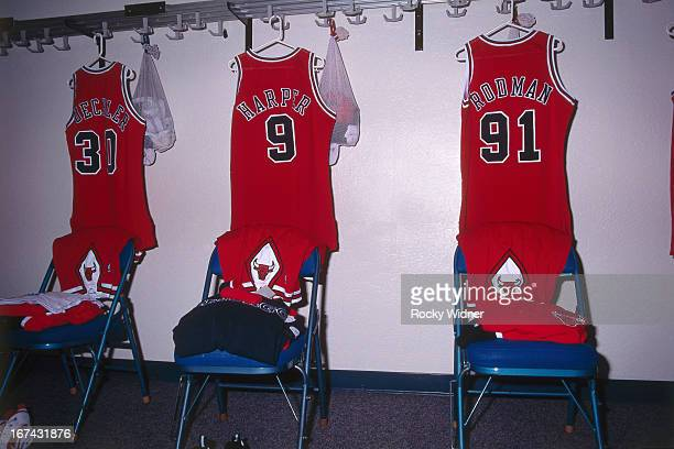 Jud Buechler Ron Harper and Dennis Rodman of the Chicago Bulls jerseys hang in the lockerroom against the Sacramento Kings on February 1 1996 at Arco...