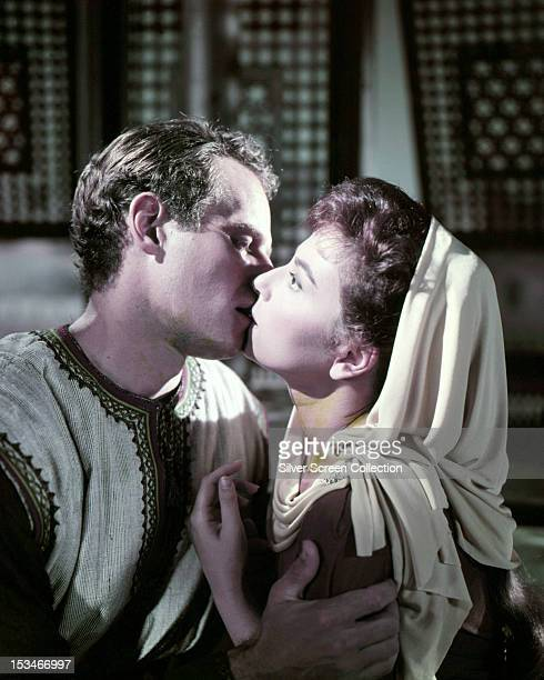 Judah BenHur played by American actor Charlton Heston kisses Esther played by Haya Harareet in a scene from 'BenHur' directed by William Wyler 1959
