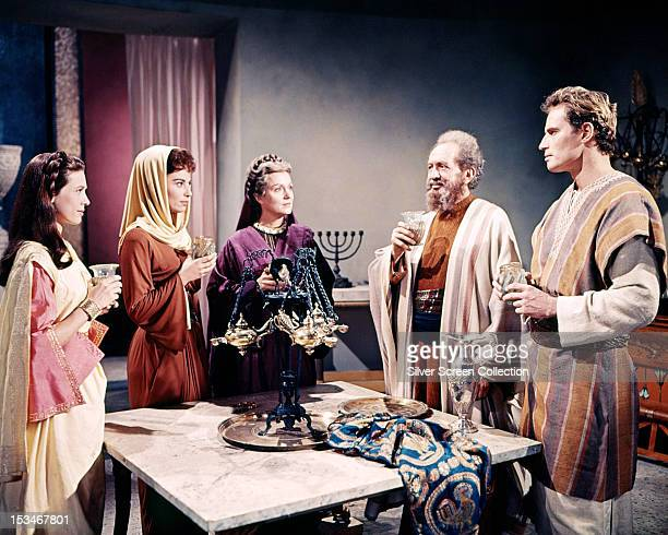 Judah BenHur played by Charlton Heston drinking a toast with his family in a scene from 'BenHur' directed by William Wyler 1959 Left to right Cathy...