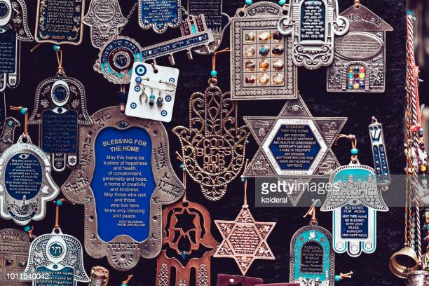 judaic amulets- david star, hamsa hand with blessings - hand of fatima stock photos and pictures