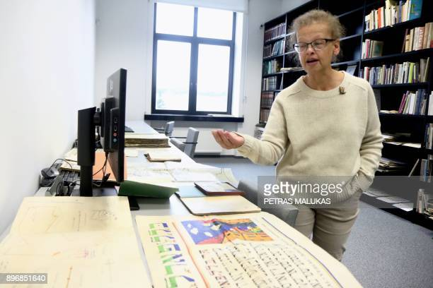 Judaica Research Centre chief Lara Lempertiene shows a map and an advertising poster as part of rediscovered Jewish collection long thought to have...