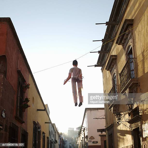 Judas hanging on rope, low angle view