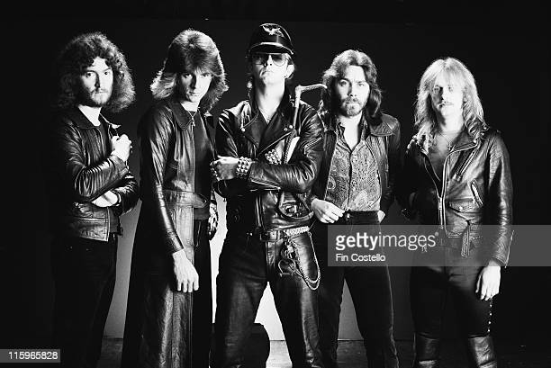 Judas Priest British heavy metal band pose against a dark background wearing black leather clothing in a group studio portrait circa 1978