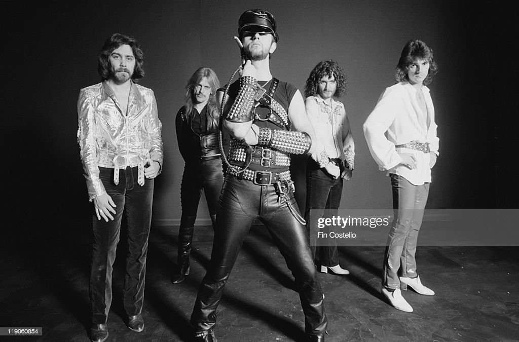 Judas Priest (drummer Les Binks, singer Rob Halford, guitarists KK Downing and Glenn Tipton and bassist Ian Hill), British heavy metal band, pose for a group studio portrait, in January 1979.