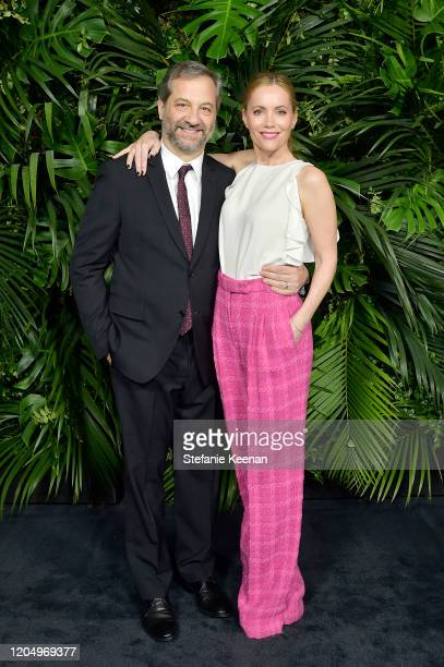 Judd Apatow and Leslie Mann, wearing CHANEL, attend CHANEL and Charles Finch Pre-Oscar Awards Dinner at Polo Lounge at The Beverly Hills Hotel on...