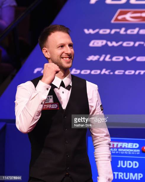 Judd Trump celebrates as he wins the 2019 Betfred World Snooker Championship final between John Higgins and Judd Trump at Crucible Theatre on May 06...