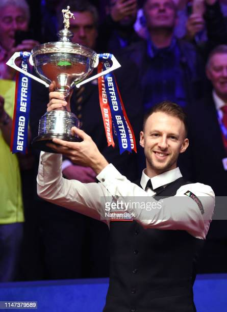 Judd Trump celebrates as he wins the 2019 Betfred World Snooker Championship final between John Higgins and Judd Trump at Crucible Theatre on May 06,...