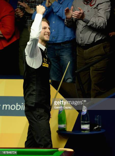 Judd Trump celebrates beating Shaun Murphy during their Quarter Final match in the Betfair World Snooker Championship at the Crucible Theatre on May...
