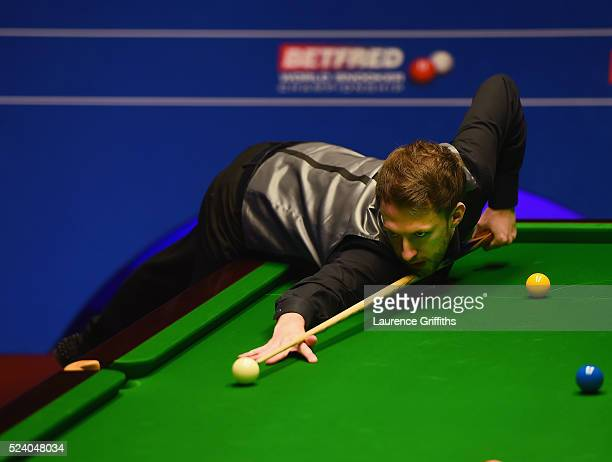 Judd Trump in action during his match against Ding Junhui during the World Snooker Championship second round match at Crucible Theatre on April 25...