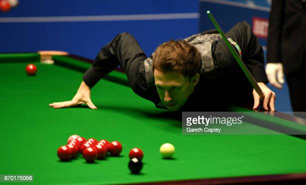 Judd Trump lines up a shot against Rory McLeod during their first round match of the World Snooker Championship at Crucible Theatre on April 19 2017...