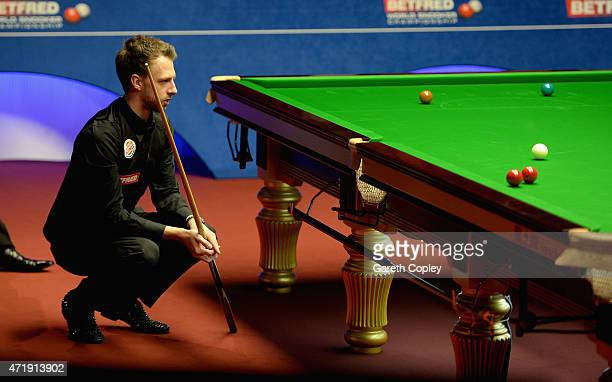 Judd Trump lines up a shot against Stuart Bingham during their semi final on day fifteen of the 2015 Betfred World Snooker Championship at Crucible...