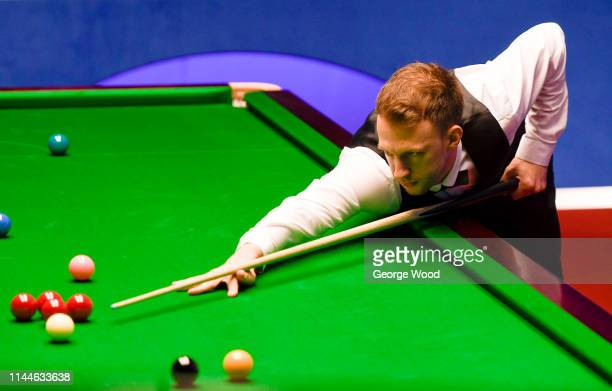 Judd Trump lines up a shot against Thepchaiya UnNooh in the opening round of the world snooker championship at Crucible Theatre on April 23 2019 in...