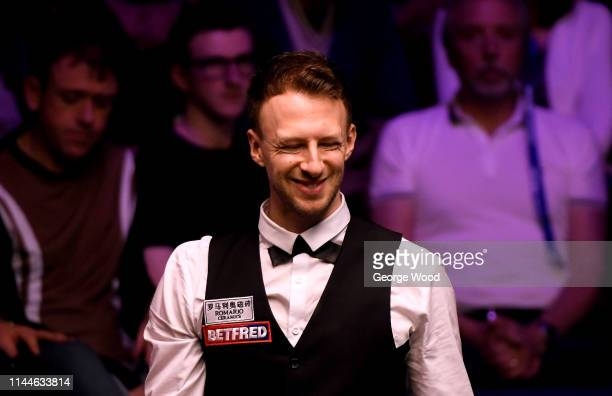 Judd Trump looks on against Thepchaiya UnNooh in the opening round of the world snooker championship at Crucible Theatre on April 23 2019 in...
