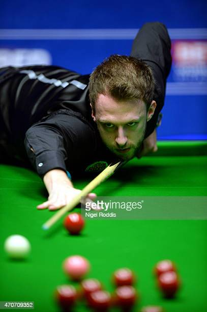 Judd Trump of England a shot against Stuart Carrington of England during day five of the 2015 Betfred World Snooker Championship at Crucible Theatre...