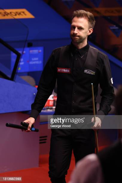 Judd Trump of England acknowledges the crowd after victory in the Betfred World Snooker Championship Round One match between Liam Highfield of...