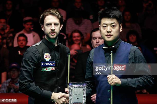 Judd Trump of England and Liang Wenbo of China pose before the final match on day seven of the Coral English Open 2016 at Event City on October 16...