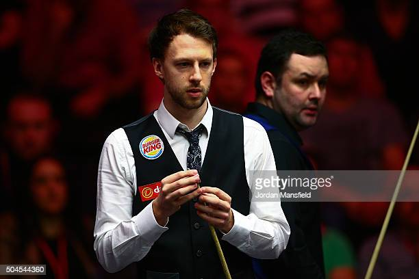 Judd Trump of England and Stephen Maguire of Scotland look on during their first round match during Day Two of the Dafabet Masters at Alexandra...