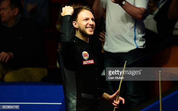 Judd Trump of England celebrates victory during his first round match against Liang Wenbo of China on day six of the World Snooker Championship at...
