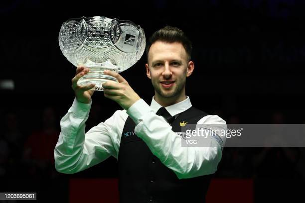 Judd Trump of England celebrates with his trophy after winning the final against Neil Robertson of Australia on day five of the German Masters 2020...