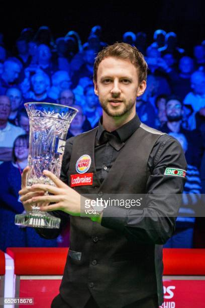 Judd Trump of England celebrates with his trophy after winning the final match against Marco Fu of Chinese Hong Kong on day seven of 2017 Ladbrokes...