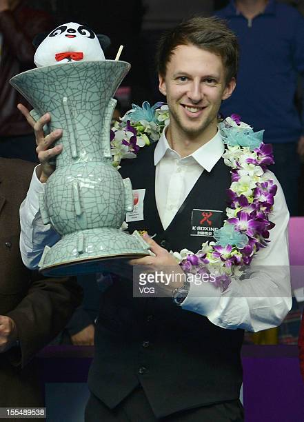 Judd Trump of England celebrates with the winners trophy after his match against Neil Robertson of Australia on day eight of the 2012 World Snooker...