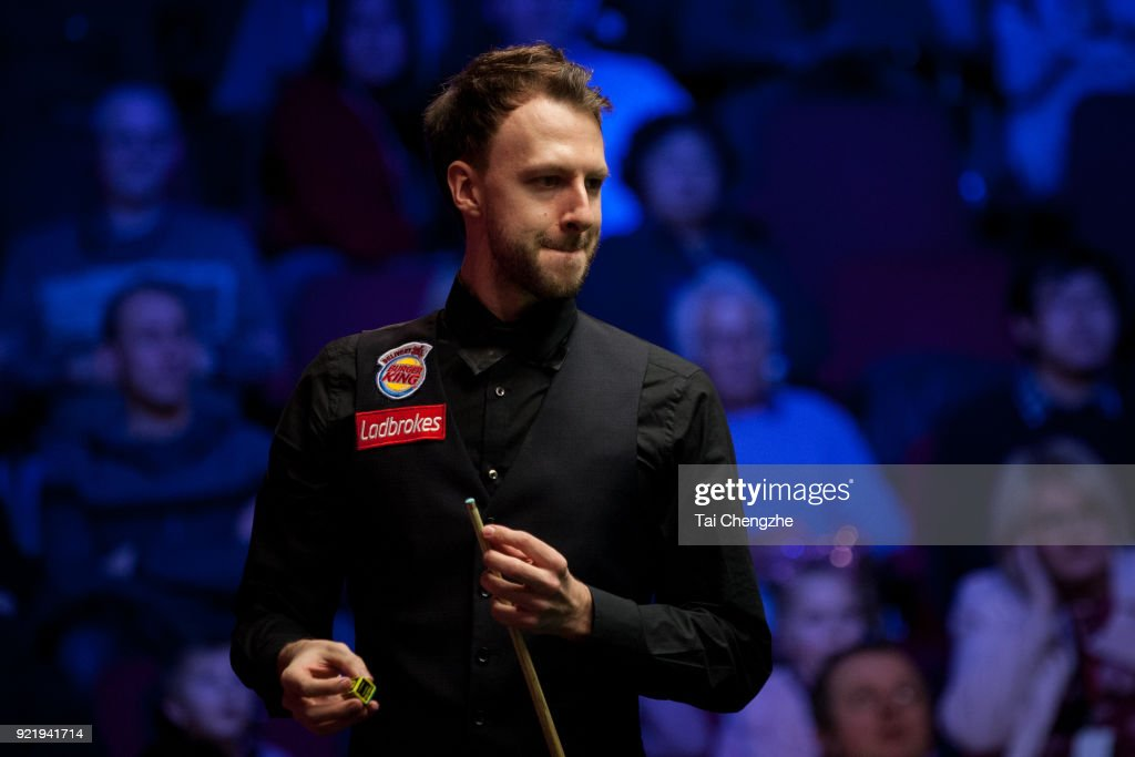 Judd Trump of England chalks the cue during his first round match against Michael White of Wales on day two of 2018 Ladbrokes World Grand Prix at Guild Hall on February 20, 2018 in Preston, England.